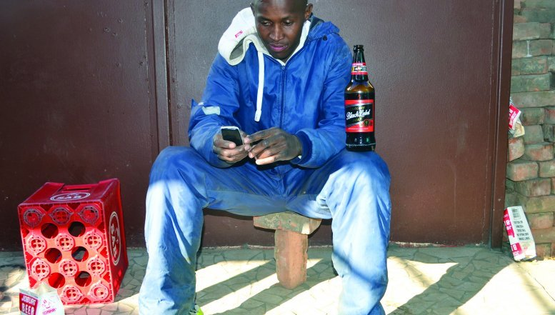 Albert Moletsana enjoys his beer at a local shebeen