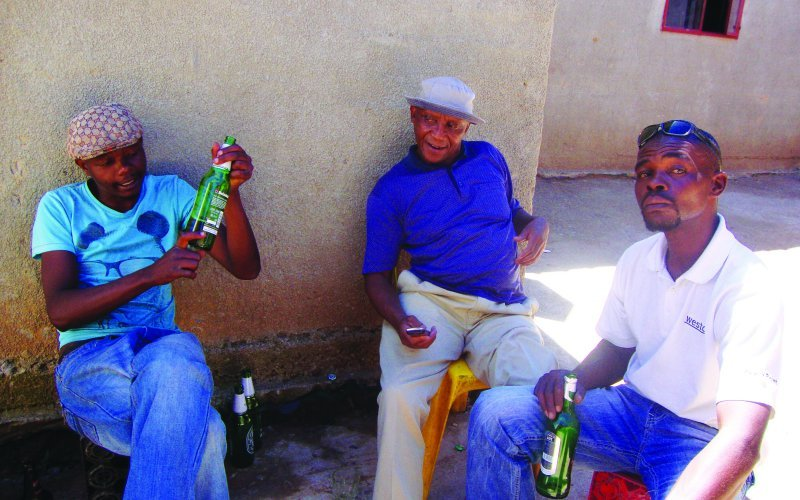 South African popular actor, Jerry Phele and his friends at a local shebeen in Soweto.