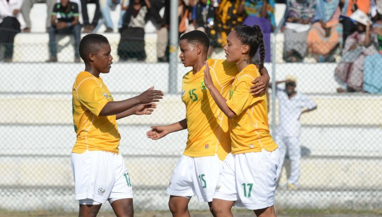 Portia Modise, Refiloe Jane and Leandra Smeda of South Africa celebrate a goal during the African Womens Championship Qualifiers