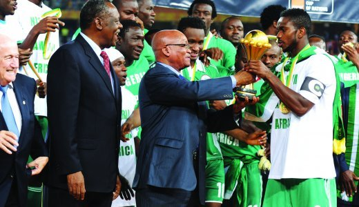 President Jacob Zuma and CAF president Issa Hayatou handing the cup to Nigerian captain Joseph Yobo as winners of AFCON 2013. Image By Courtesy of GCIS.JPG