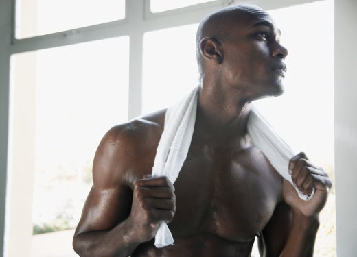Young man with towel around neck