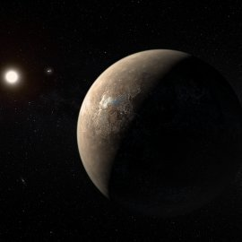 Artist's_impression_of_Proxima_Centauri_b_shown_hypothetically_as_an_arid_rocky_super-earth.jpg
