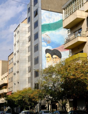 Tehran street with mural featuring Ayatollahs Khomeini (l.) and Khameini (rt.).jpg