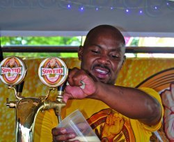 Mandla Mbatha, bartender at Soweto Gold beer EDIT.JPG
