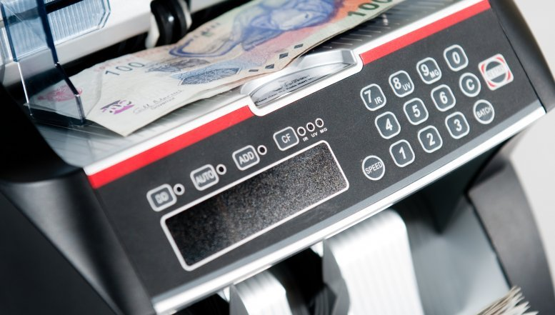 Most money counting machines have built-in counterfeit detection.
