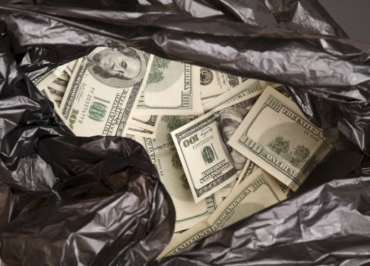 Rubbish bag with dollars.