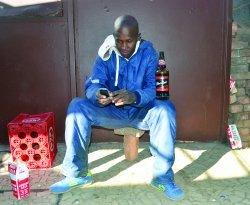Albert Moletsana enjoys his beer at a local shebeen.jpg