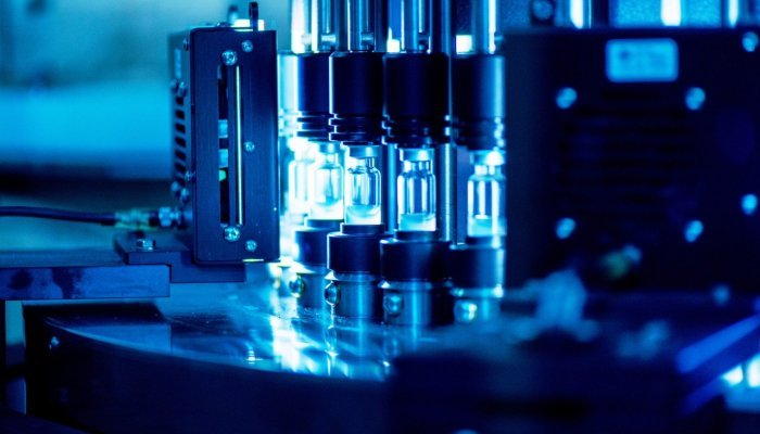 Vials from a production line at Biovac are inspected by an automatic visual inspection machine