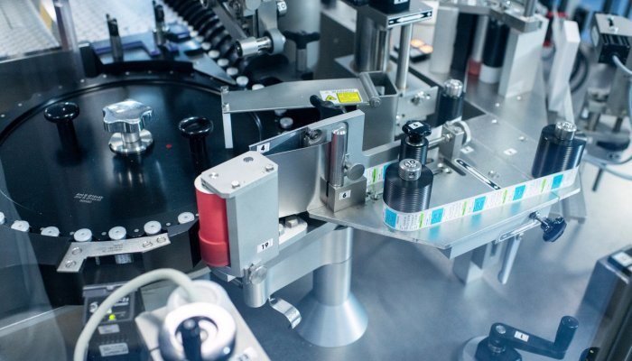 A vial labelling machine used for packaging of various finished products at Biovac's facility in Cape Town