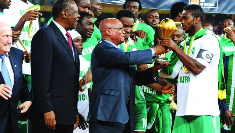 President Jacob Zuma and CAF president Issa Hayatou handing the cup to Nigerian captain Joseph Yobo as winners of AFCON 2013.