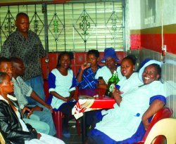 (Standing) is the owner of Billy's Place in Katlehong, Billy Thapelo Mokoena and his customers..JPG