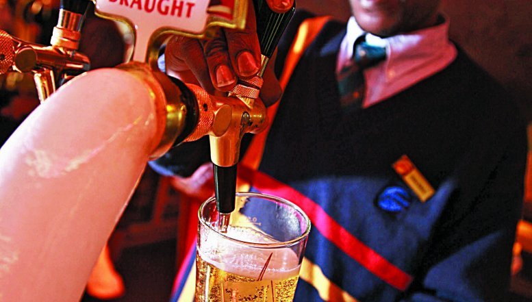 A barman pouring draught beer.