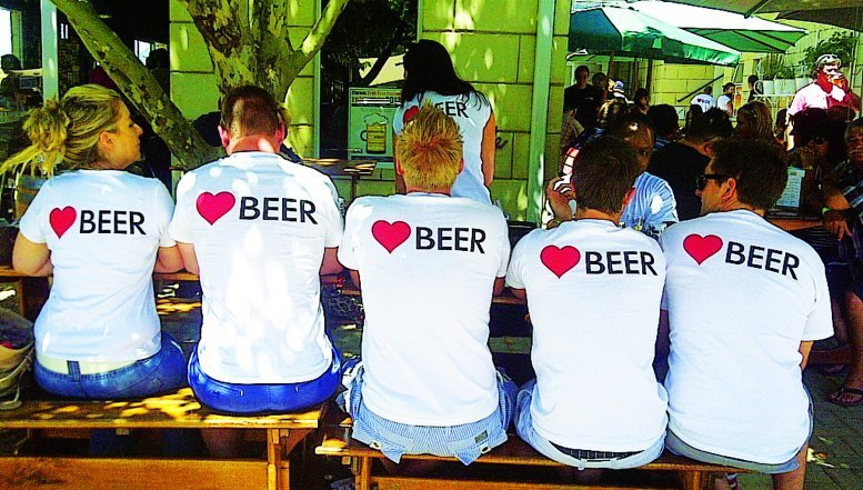 "Beer lovers wearing popular SAB's 'love beer"" t-shirts."