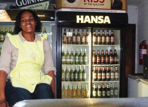 Mpho Zondi is the proud owner Xoli's Pub & Restaurant in Zola, Zone 1. (800x600).jpg