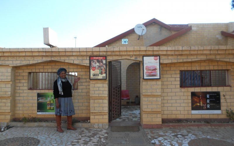 Sarah Maaroganye stands in front of the entrance to My Lovies - Delicious Food & Booz